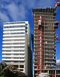 """Fontainebleau's """"spite wall"""" on the left and Eden Roc's new tower on right."""