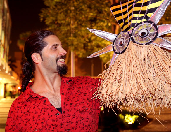 Amir Sultan Roth admires Kikimora's latest headpiece creation