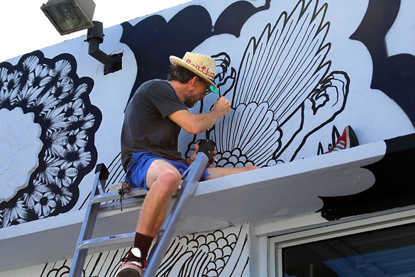 Artist Carl Janes at work on a 24th Street mural
