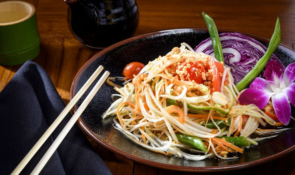 Chef Bee says his Papaya Salad captures the essence of his Thai childhood and brings those bold flavors to the table at NaiYaRa