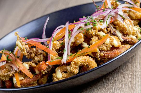 Chef Diego Munoz's Salt & Pepper Fried Calamari Jalea at 1111 Peruvian Bistro