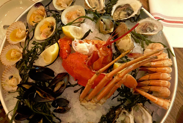 Sip champagne and sample fresh oysters at Le Zoo in the Bal Harbour Shops