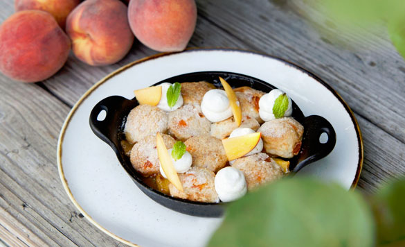 Executive Pastry Chef Jill Montinola's summery Peach Cobbler is easy to DIY at home