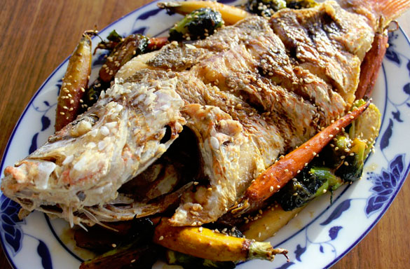 Whole Red Snapper with lemon, chard, Brussels sprouts and baby carrots