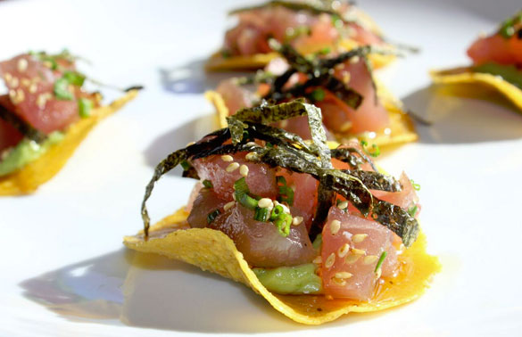 Flavorful crisps topped with Tuna Poke, avocado, nori and sesame seeds