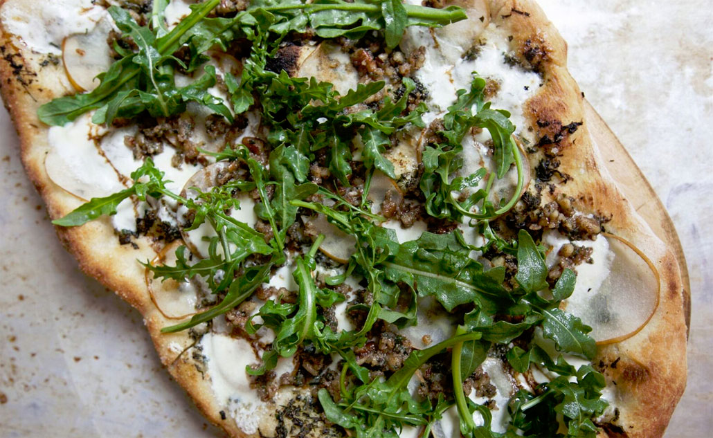 Upland's Pear Pizza topped with Baby Arugula